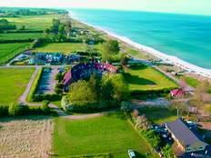 D 1 /3*** Sterne TERRASSEN-WOHNUNG mit Meerblick.  Kostenfrei sind Strandkorb/WLAN und Schwimmbad in Kronsgaard